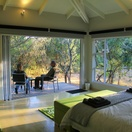 Green Bed View with guests outside, Green Monkey Orange, Boutique, Bushwillow  Collection